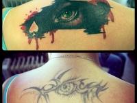 Татуировка взгляд на спине