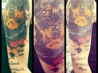 Татуировка ротвейлер на плече