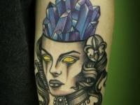 Татуировка голова на предплечье
