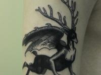 Татуировка летящий олень
