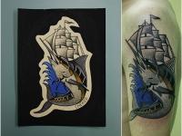 Татуировка осетр и корабль на плече