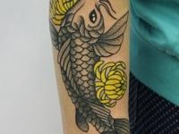 Татуировка рыба на предплечье