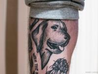 Татушка в виде головы собаки на руке