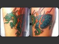 Татуировка дракон на икре