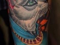 Татуировка кот на предплечье