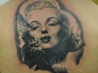 Татуировка Мэрилин Монро на спине