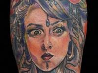 Татуировка девушка на икре