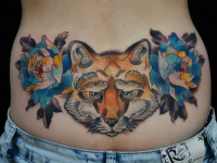 Татуировка лисица на животе