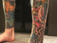 Татуировка цветы на голеностопе
