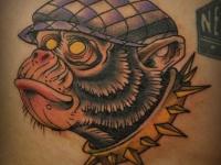 Татуировка голова обезьяны в кепке