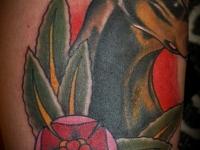 Татуировка собака с цветком