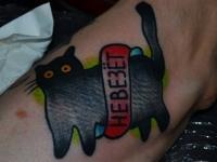 Татуировка черный кот