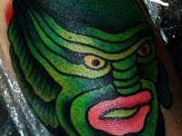 Татуировка голова монстра