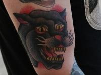 Татуировка голова пантеры на плече