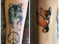 Татуировки на предплечье головы волка и лисы