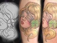Татуировка девушка с повязкой на глазах