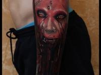 Татуировка вурдалак на предплечье