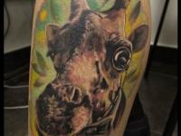 Татуировка голова жирафа на икре
