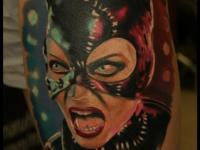 Татуировка голова девушки в маске
