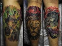Татуировка головы животных на икре