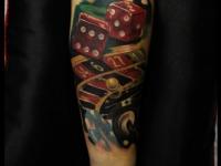 Татуировка рулетка на предплечье