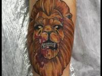 Татуировка морда льва на предплечье