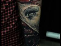 Татуировка ужастик на предплечье