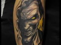 Татуировка лицо на руке