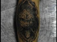 Татуировка морда льва