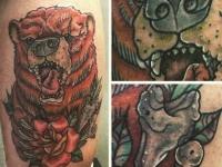 Татуировка головы медведя с розой на руке