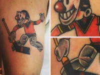 Татуировка хоккеиста с клюшкой на руке