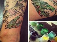 Татуировка головы крокодила на руке