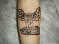 Татуировка сова на предплечье