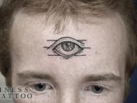 Татуировка глаз на лбу