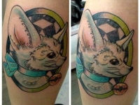 Татуировка голова собачки на икре
