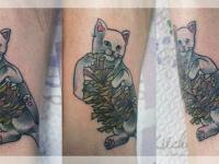 Татуировка кот с шишкой