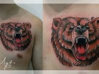 Татуировка голова медведя на груди