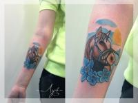 Татуировка голова лошади на предплечье