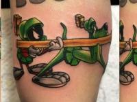 Татуировка собаки из мультика на руке