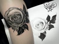 Татушка в виде розы на руке