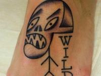 Татуировка череп на стопе