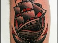 Татуировка корабль и якорь на икре