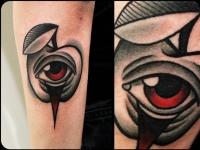 Татуировка яблоко с глазом