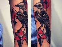 Татуировка птица на предплечье