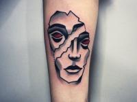 Татуировка раздвоенное лицо