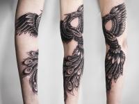 Татуировка жар-птица на руке