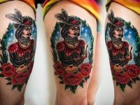 Татуировка художник на бедре