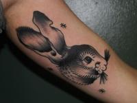 Татуировка головы зайца на руке