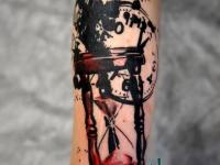 Татуировка часы на предплечье