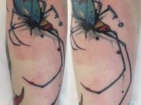 Татуировка паук на икре